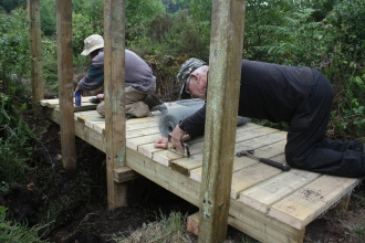 Bystock local group build a new bridge at Bystock Pools