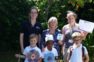 Children given an award for school gardening