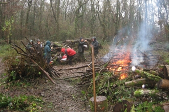 Conservation work party clearing small areas of wood