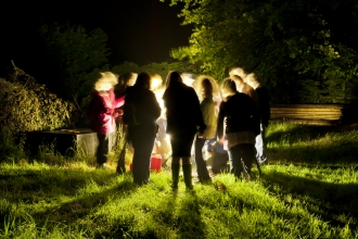 People looking at a moth trap in Okehampton
