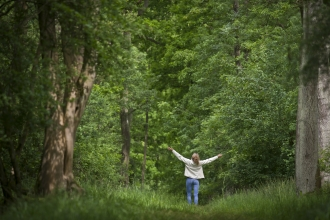 Woman loving wildlife in the woods