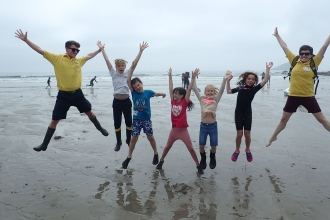 Wembury Beach Summer Holiday Club children jumping