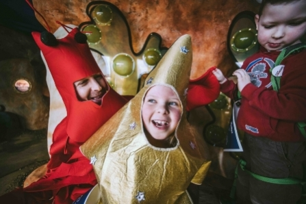 Children dressed up in a star costume at Seaton Jurassic