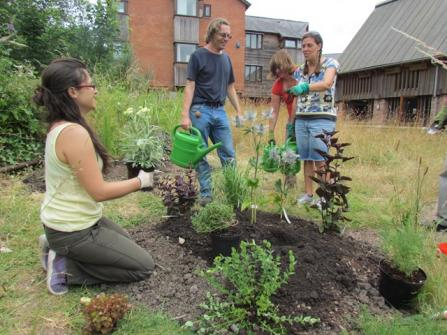 Volunteers tend the Cricklepit Mill garden