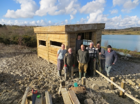 Volunteers constructing a bird hide at Meeth Quarry