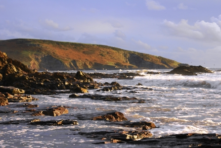 Waves crashing against the rocks at Wembury beach